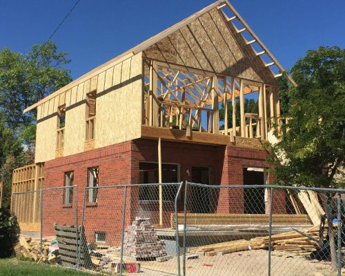 ArcWest Architects Residential Addition Pontiac - progress - trusses up